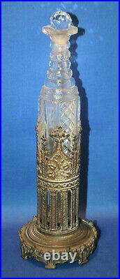 An antique 19th century gothic arch scent or condiment bottle holder, cut glass